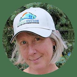 guide Nadine Fletcher wearing Great Divide baseball hat