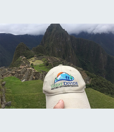 Great Divide baseball hat at Machu Picchu